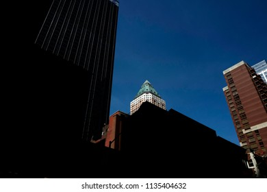 NEW YORK, UNITED STATES, JUNE-17, 2018: light and shadow on the nyc buildings of Manhattan, in New York.