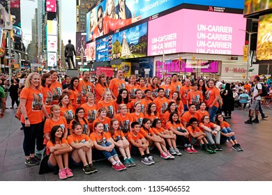 NEW YORK, UNITED STATES, JUNE-17, 2018: orange dressed tourists group photo at Times Square in Manhattan, in New York.