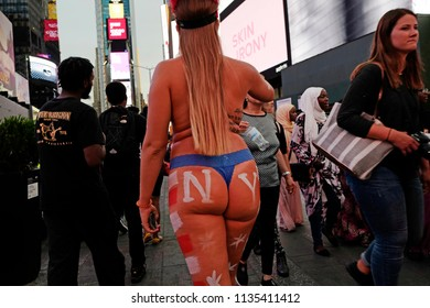NEW YORK, UNITED STATES, JUNE-17, 2018: naked female buttocks with nyc painted logo at Times Square in Manhattan, in New York.