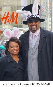 New York, New York / United States - March 27, 2016: Couple wearing rabbit ears at the Fifth Avenue Easter Parade.
