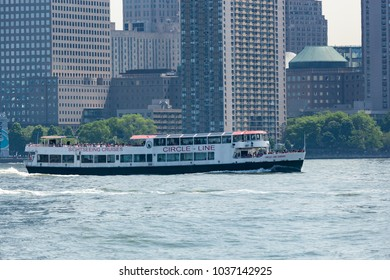 NEW YORK, NEW YORK / UNITED STATES - May 25, 2016: The Circle Line Queens of the Circle-Line Cruise boats navigates the Hudson in front of the World Trade Center