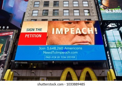 New York, United States - November, 18th, 2107. An advertising in time square about Donald Trump impeachment. United States impeachment petition