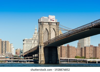 NEW YORK, UNITED STATES - Sep 26, 2014: A view of the Brooklyn Bridge with a view of Manhattann by day and a clear sky