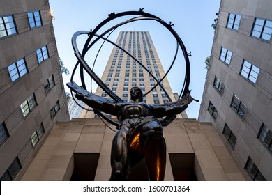 New York, United States - September 21, 2019: Low angle view of the Atlas Statue in Rockefeller Center. Created by Lee Lawrie in 1937.