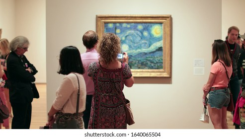 NEW YORK, UNITED STATES, SEPTEMBER 21 2017 - People looking at Art exhibition at the MOMA NY, The Museum of Modern Art