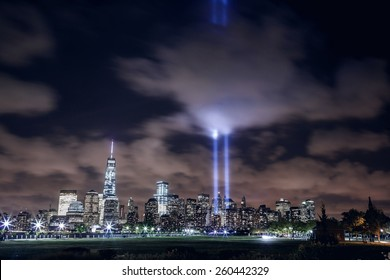 NEW YORK, UNITED STATES - SEPTEMBER 11: illuminated Manhattan skyline with two beams of light in memory of 9/11 over Hudson River, New York City on September 11, 2014