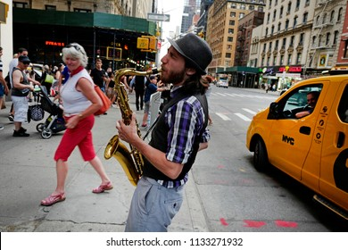 NEW YORK, UNITED STATES-JUNE 17, 2018: musician playing saxophone on the streets of Manhattan, in NewYork.