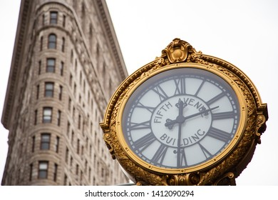 NEW YORK, US - APRIL 29, 2019:  A clock with Flat Iron building behind.
