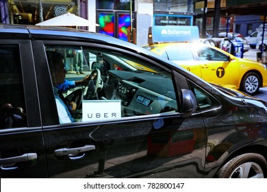 New York, US - August 23, 2015. Uber car service on the streets of New York