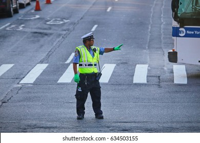 New York, US - August 24,2016: policeman regulating traffic on city streets