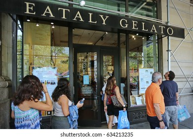 NEW YORK, US- August 25, 2015: People inside Eataly shop in Manhattan. Eataly is a high-end Italian food market/mall
