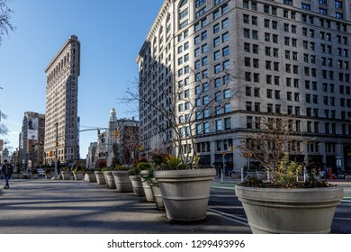 New York, New York / USA - 01 07 2019: Flatiron building district on downtown Manhattan, 5th avenue. Street decoration, daytime, blue sky.