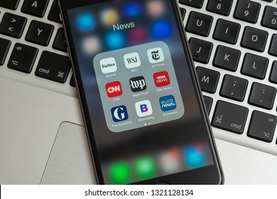 New York / USA - 02/23/2019: Black Apple iPhone with icons of News media: Forbes, WSJ, NY Times, CNN, WP, BBC News, Guardian, Bloomberg and Euronews applications on screen. News media icons.