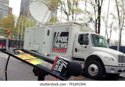 New York, USA - 04 27 2017: Microphone of a Fox News TV Reporter in Front of a Broadcasting Truck with Satellite Dish