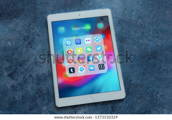 New York / USA - 04/12/2019: White Apple iPad Air with icons of social media: instagram, youtube, facebook, pinterest, twitter, snapchat application on screen. Social media icons. Marketing concept.