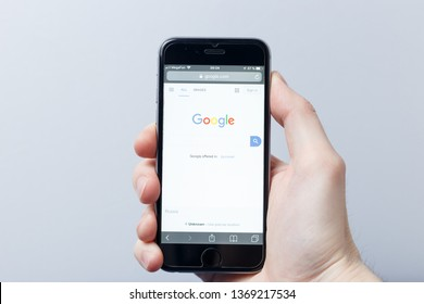 New York / USA - 04.14.2019: A hand holding a smartphone which displays Google logo on the official website homepage. Google logo visible on smartphone screen. Illustrative editorial