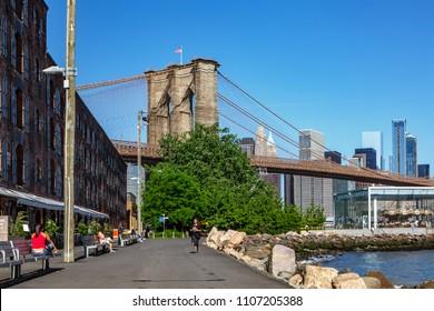 New York, New York / USA - 05 22 2018: New York city view, Manhattan from Brooklyn bridge park and street around
