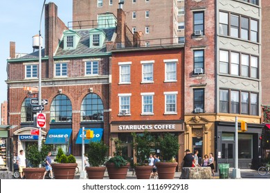 New York, New York / USA - 06 17 2018: Manhattan streets, and buildings facade, store, restaurant and cafe and apartments.