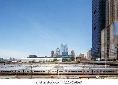 New York, New York / USA - 06 17 2018: Manhattan streets, mta subway park and skyscrapers.