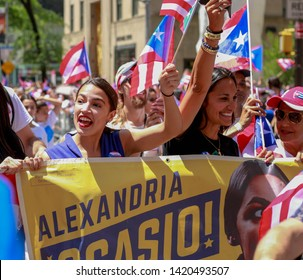 New York, New York / USA - 06/09/2019 Alexandria Ocasio-Cortez attending this years annual New York city Puerto Rican day Parade on 5th ave , in Manhattan