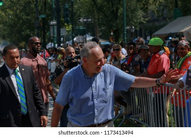New York , New York / USA 09/03/2018 . New York Senator Chuck Schumer greeting the crowd at New York Cities West Indie day parade in Brooklyn , NYC