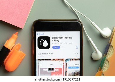 New York, USA - 1 December 2020: Lightroom Presets - Filtry mobile app icon on phone screen top view, Illustrative Editorial.