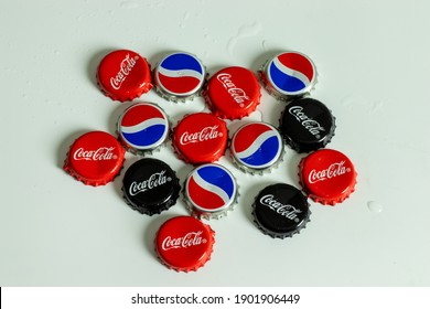 New York, USA - 1 January 2021: Top view of Pepsi and Coca-Cola bottle cap with logo. Coke brand, Illustrative Editorial