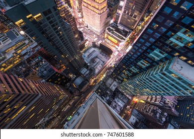 New York, USA - 10 May 2017:  Bird's eye view of Manhattan, looking down at people and yellow taxi cabs going down 5th Avenue.