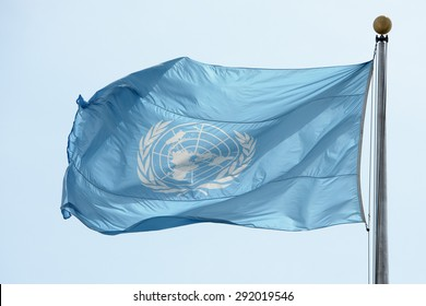 NEW YORK - USA - 11 JUNE 2015 Waving united nations UN flag in the deep blue sky background