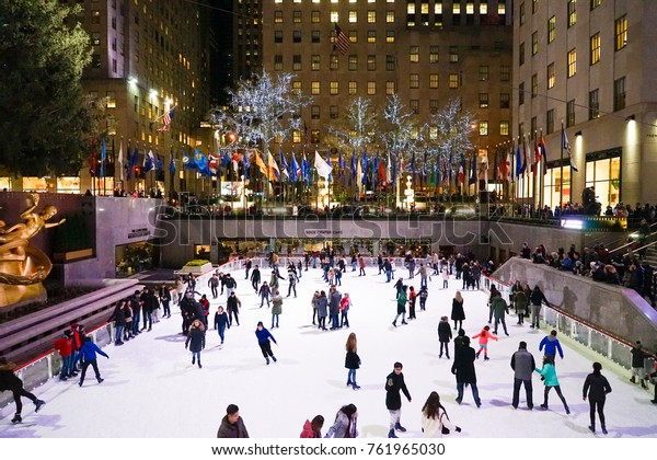 New York, USA - 17 November 2017. The Rink At Rockefeller, a seasonal ice skating rink with a golden statue underneath Rockefeller Building.