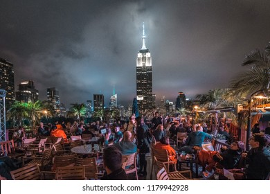 New York, USA - 20 may 2017: 230 Fifth Rooftop Bar with fantastic view of the Empire State Building at night.