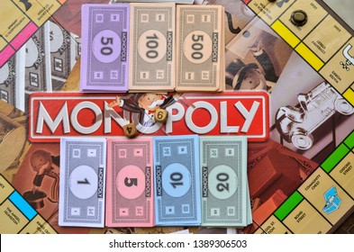 New York, USA, 2019. Fake currency notes/ paper money and dice neatly arranged on monopoly board game.
