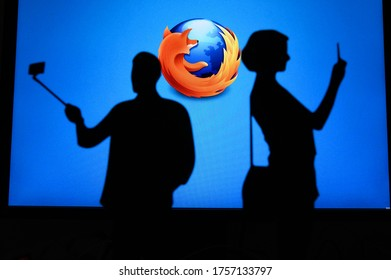 NEW YORK, USA, 25. MAY 2020: Mozilla Firefox web browser . Couple taking a photo on a mobile man use a selfie stick. Company logo on screen in background