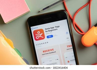 New York, USA - 26 September 2020: Zenia Yoga for Beginners mobile app logo on phone screen close up, Illustrative Editorial.