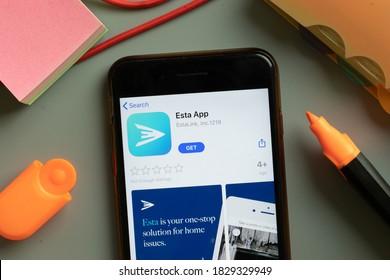 New York, USA - 29 September 2020: Esta App mobile logo on phone screen close up, Illustrative Editorial.