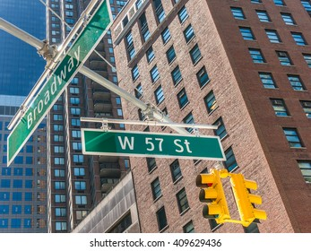 New York, USA - 4 September 2014: View of street signs on the corner of Broadway and West 57th Street in Manhattan, New York.