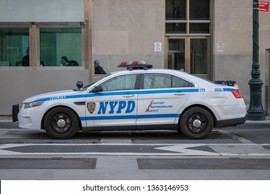 New York USA, 8th April 2019: A United States of America yellow Police car from the NYPD traveling on a road in New York City