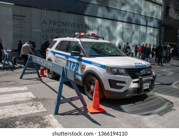 New York USA, 8th April 2019: A United States of America police car NYPD behind a police barrier on a road in New York City