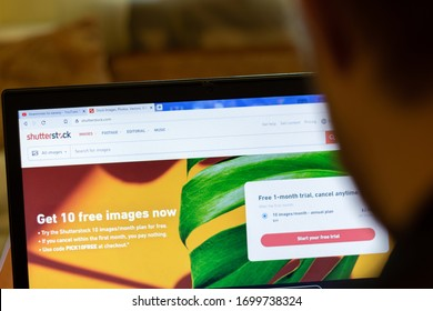 New York, USA - 9 April 2020: Shutterstock website on laptop screen close up. Man using service on display, blurry background, Illustrative Editorial.