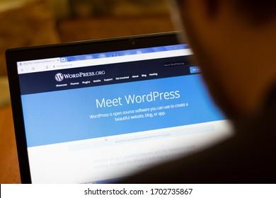 New York, USA - 9 April 2020: WordPress website on laptop screen close up. Man using service on display, blurry background, Illustrative Editorial.