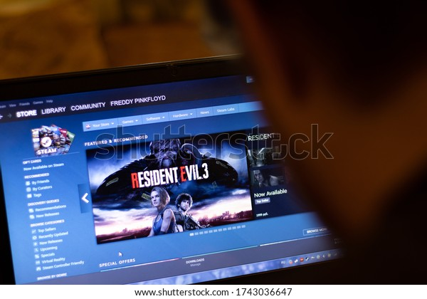 New York, USA - 9 April 2020: Steam game store application on laptop screen close up. Man using service on display, blurry background, Illustrative Editorial.