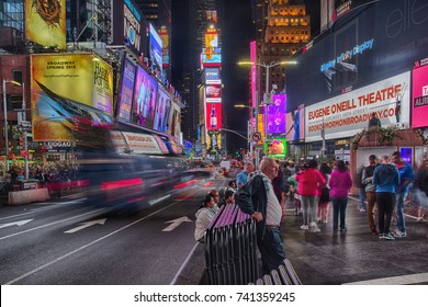NEW YORK, USA - 9 of October 2017: Broadway Times Square at night, with a lot of displays, neon lights and other advertisement, cars on road and people. HDR image