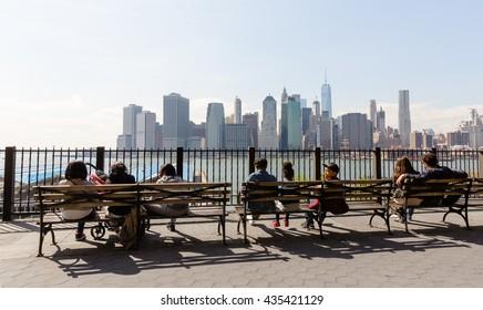 NEW YORK, USA - Apr 27, 2016: Manhattan skyline from Brooklyn Heights Promenade. People relax and enjoy the stunning views of Manhattan