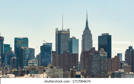 NEW YORK, USA - APR 28, 2020: Blue Angel and Thunder Bird formation fly over New York City to pay tribute to frontline responders and hospital workers.