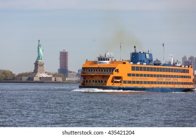 NEW YORK, USA - Apr 28, 2016: Staten Island Ferry passing Statue of Liberty in New York Harbor. Staten Island Ferry is a passenger ferry service operated by New York City Department of Transportation