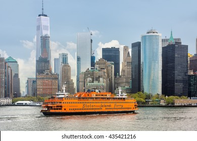 NEW YORK, USA - Apr 28, 2016: Staten Island Ferry on the New York Harbor against of Lower Manhattan skyscrapers