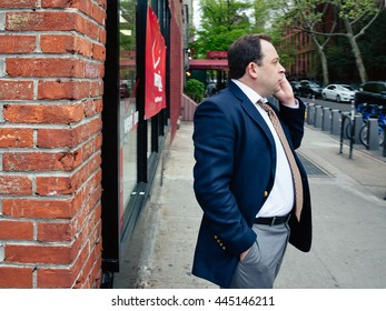 NEW YORK, USA - Apr 28, 2016: Manhattan street scene. The Americans on the streets of New York. Elegant man with a mobile phone