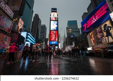 NEW YORK, USA - Apr 30, 2016: Times Square in the rainy evening. Brightly adorned with billboards and advertisements, Times Square is sometimes referred to as The Crossroads and The Heart of the World