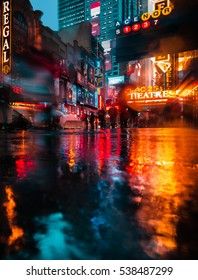 NEW YORK, USA - Apr 30, 2016: Lights and shadows of New York City. NYC streets after rain with reflections on wet asphalt. Silhouettes of people walking on the street