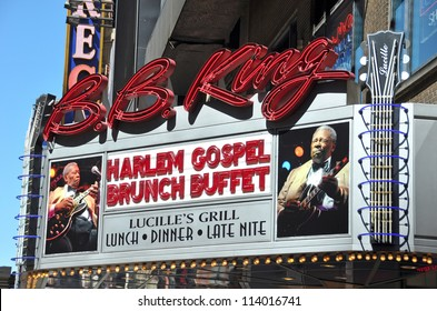NEW YORK, USA - APRIL 05: Outside the famous BB King Blues Club & Grill on 42nd Street on a sunny Sunday morning in Spring. The Harlem Gospel Choir perform on April 05, 2008 in New York.